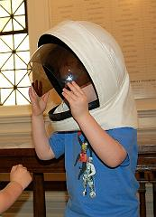 Trying a space helmet on for size at the Music Institute of Chicago Blast Off Concert - Sept. 2007
