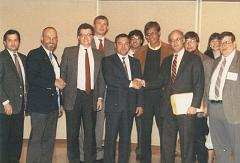 Left to right: Phil Boyce, astronaut Dr. Loren Acton, Jim Plaxco, Bill Schmid, cosmonaut Colonel Yuri Victorovich Romanenko, David White, Joe Redfield, Jeffrey Liss, Bill Higgins, Melissa Bodeau, and Larry Ahearn October 10, 1989 at the Northeastern Illinois University Distinguished Lectureship Series event where cosmonaut Colonel Yuri Victorovich Romanenko and astronaut Dr. Loren Acton spoke on U.S./Soviet cooperation in space exploration and development.
